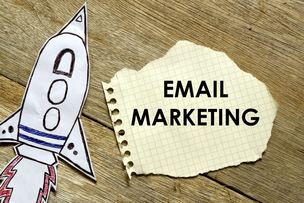 Paper rocket with paper written EMAIL MARKETING