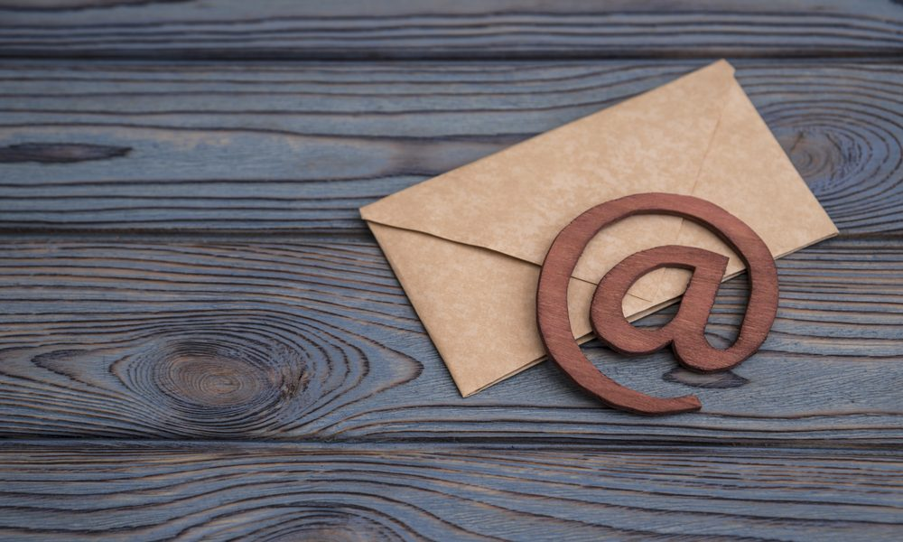 e-mail symbol on a vintage mail envelope - How to Succeed in Email Marketing?